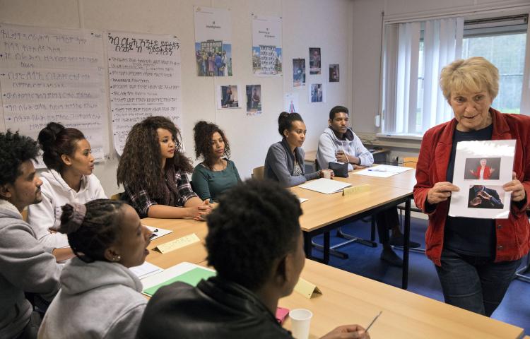 Statushouders in leslokaal volgen training VOORwerk